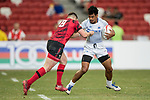 Owen Lane of Wales (left) tries to tackle Tila Mealoi of Samoa during the match Wales vs Samoa, Day 2 of the HSBC Singapore Rugby Sevens as part of the World Rugby HSBC World Rugby Sevens Series 2016-17 at the National Stadium on 16 April 2017 in Singapore. Photo by Victor Fraile / Power Sport Images