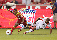 Joao Plata #8 of Real Salt Lake takes the ball from Ethan White #15 of D.C. United during the first half of the U.S. Open Cup Final on October  1, 2013 at Rio Tinto Stadium in Sandy, Utah.