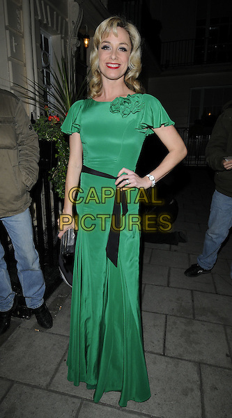 TAMZIN OUTHWAITE.Attending the 'Sweet Charity' Press Night at the Theatre Royal, Haymarket, London, England UK, May 4th 2010. .full length black belt sash green silk satin maxi dress corsage hand on hip.CAP/CAN.©Can Nguyen/Capital Pictures.