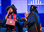 Graduates react as they receive their degrees from Salma Ghanem, dean of the College of Communication, Sunday, June 11, 2017, during the DePaul University College of Computing and Digital Media and the College of Communication commencement ceremony at the Allstate Arena in Rosemont, IL. (DePaul University/Jamie Moncrief)