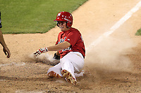 Memphis Redbirds outfielder James Rapoport #44 slides into home during a game versus the Round Rock Express at Autozone Park on April 29, 2011 in Memphis, Tennessee.  Round Rock defeated Memphis by the score of 5-4 in 13 innings.  Photo By Mike Janes/Four Seam Images