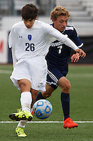 Mishawaka Marian's Francisco Tavarez (26) plays the ball away from Providence's Isaac Coker (7) during the IHSAA Class A Boys Soccer State Championship Game on Saturday, Oct. 29, 2016, at Carroll Stadium in Indianapolis. Marian won 4-0. Special to the Tribune/JAMES BROSHER
