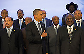 United States President Barack Obama takes part in the family photo at the Africa Leaders Summit, standing in between Mohamed Ould Abdel Aziz, President of the Islamic Republic of Mauritania (Left) and Hifikepunye Pohamba, President of the Republic of Namibia (Right), at the State Department in Washington DC, August 6, 2014. Obama is promoting business relationships between the United States and African countries during the three-day U.S.-Africa Leaders Summit, where 49 heads of state are meeting in Washington.  <br /> Credit: Molly Riley / Pool via CNP