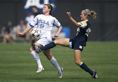 September 01, 2013:  Notre Dame forward Kaleigh Olmsted (27) and UCLA defender Chelsea Stewart (19) battle for the loose ball during NCAA Soccer match between the Notre Dame Fighting Irish and the UCLA Bruins at Alumni Stadium in South Bend, Indiana.  UCLA defeated Notre Dame 1-0.