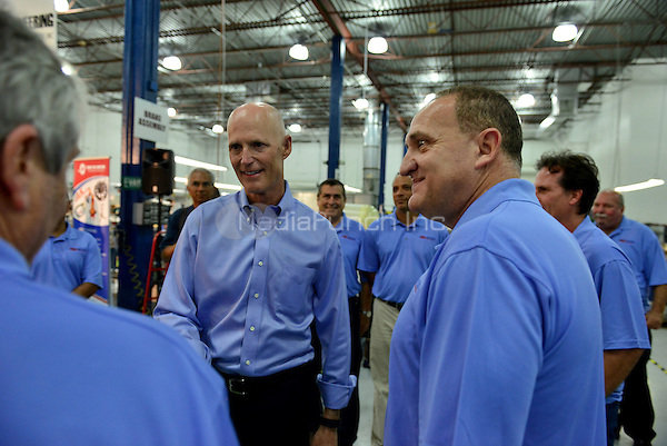 HOLLYWOOD, FL -  JULY 07: Florida Governor Rick Scott, speaks during a news conference at Aerospace Precision, Inc. after a tour of the facility to highlight job growth in Hollywood on Tuesday July 7, 2015 in Hollywood, Florida. Credit: MPI10 / MediaPunch