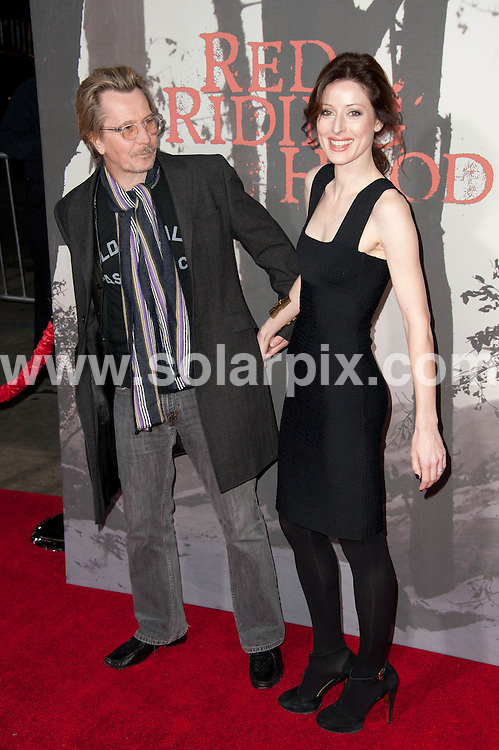 **ALL ROUND PICTURES FROM SOLARPIX.COM**                                             **SYNDICATION RIGHTS FOR UK, AUSTRALIA, DENMARK, PORTUGAL, S. AFRICA, SPAIN & DUBAI (U.A.E) & ASIA (EXCLUDING JAPAN) ONLY**                                                                                  Caption: arrivals at the Los Angeles Premiere of - Red Riding Hood - held at the Grauman's Chinese Theater - Hollywood, CA, USA. 7 March 2011                                                                         This pic: Gary Oldman and Donya Fiorentino                                                                                         JOB REF: 12932 PHZ Gabber      DATE: 07_03_2011                                                          **MUST CREDIT SOLARPIX.COM OR DOUBLE FEE WILL BE CHARGED**                                                                      **MUST AGREE FEE BEFORE ONLINE USAGE**                               **CALL US ON: +34 952 811 768 or LOW RATE FROM UK 0844 617 7637**