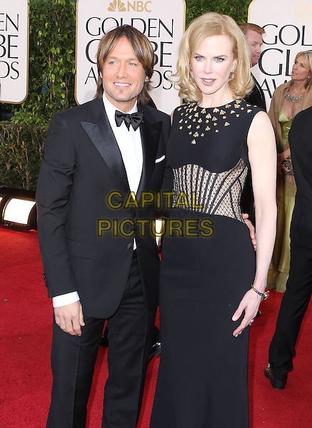 Keith Urban & Nicole Kidman.70th Annual Golden Globe Awards held at the Beverly Hilton Hotel, Hollywood, California, USA..January 13th, 2013.globes half length dress sleeveless stripe corset sheer black white bow tie tuxedo stubble facial hair gold beads beaded sleeveless married husband lace wife 3/4.CAP/ADM/SLP/COL.©Collin/Starlitepics/AdMedia/Capital Pictures.