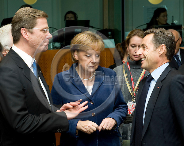 Brussels-Belgium - October 29, 2009 -- European Council, EU-summit under Swedish Presidency; here, Guido WESTERWELLE (le), Minister for Foreign Affairs of Germany, Angela MERKEL (ce), Federal Chancellor of Germany, and Nicolas SARKOZY (ri), President of France -- Photo: Horst Wagner / eup-images