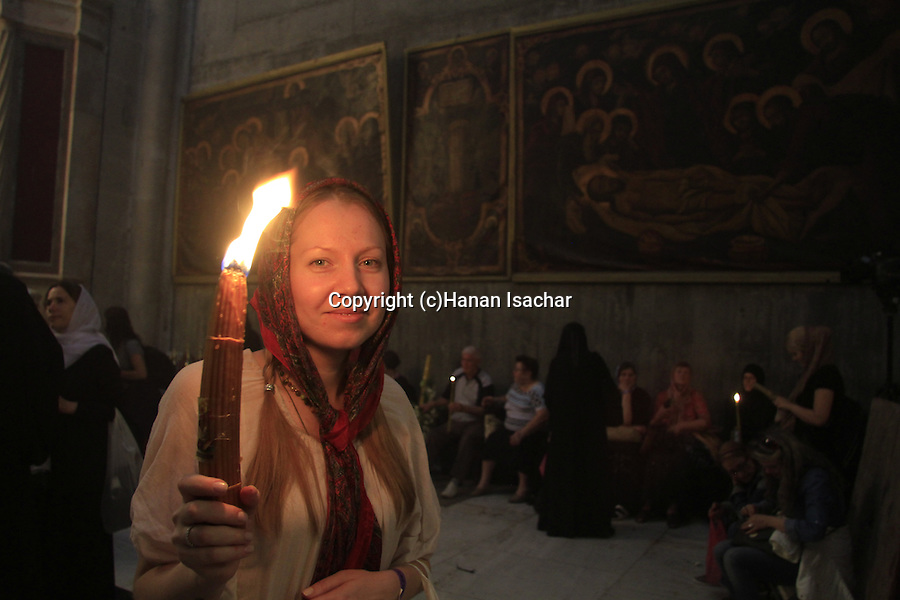 Easter, Holy Saturday, a pilgrim with the Holy Light at the Church of the Holy Sepulchre in Jerusalem