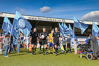 Match officials lead the team out ahead of the Sky Bet League 2 match between Wycombe Wanderers and Mansfield Town at Adams Park, High Wycombe, England on 25 March 2016. Photo by David Horn.