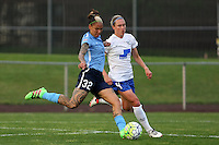 Piscataway, NJ, May 13, 2016. Forward Tasha Kai (32) of Sky Blue FC shoots the ball past  defender Whitney Engen (4).  Sky Blue FC defeated the Boston Breakers, 1-0, in a National Women's Soccer League (NWSL) match at Yurcak Field.