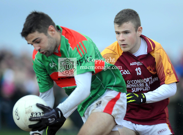 XXjob 06/01/2013* (SPORT) Kieran Duffy, Duagh , chases Paul Collins, Beale  in the North Kerry football final at Frank Sheehy Park Listowel on Sunday . Picture: Eamonn Keogh ( MacMonagle, Killarney).