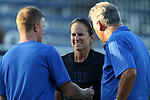 31 August 2014: Duke assistant coach Carla Overbeck (center) with head coach Robbie Church (right) and assistant coach Billy Lesesne (left). The Duke University Blue Devils hosted the University of Alabama Birmingham Blazers at Koskinen Stadium in Durham, North Carolina in a 2014 NCAA Division I Women's Soccer match. Duke won the game 3-1.