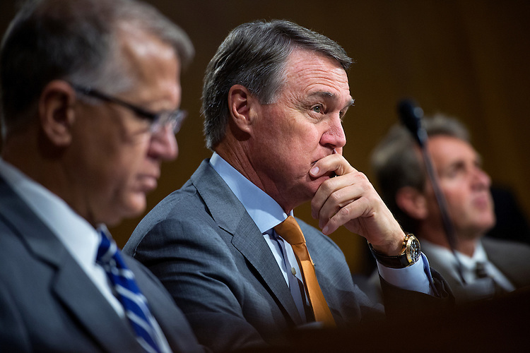 "UNITED STATES - JULY 21: From left, Sens. Thom Tillis, R-N.C., David Perdue, R-Ga., and Jeff Flake, R-Ariz., attend a Senate Judiciary Committee hearing in Dirksen Building titled ""Oversight of the Administration's Misdirected Immigration Enforcement Policies: Examining the Impact on Public Safety and Honoring the Victims,"" July 21, 2015. The hearing featured testimony of families of victims who were killed by undocumented immigrants. (Photo By Tom Williams/CQ Roll Call)"