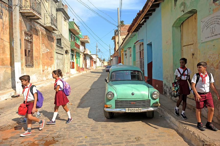 Children walk home from school in Trinidad, Cuba. MARK TAYLOR GALLERY