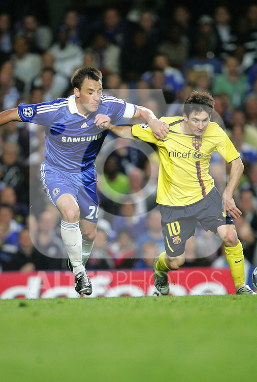 Lionel Messi holds of John Terry of Chelsea during the UEFA Champions League Semi Final Second Leg match between Chelsea and Barcelona at Stamford Bridge on May 6, 2009 in London, England.