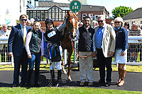 Connections of Rumble in the Jungle in the winners enclosure after winning The Penang Turf Club Malaysia Novice Stakes (Plus 10 Race) (Class 4) during Afternoon Racing at Salisbury Racecourse on 17th May 2018