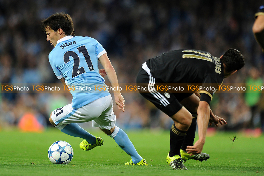 David Silva of Manchester City turns away from Hernanes of Juventus during Manchester City vs Juventus