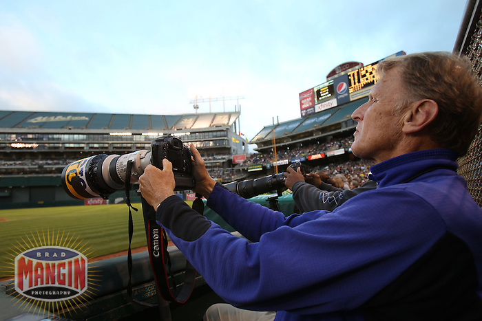 OAKLAND, CA - AUGUST 20:  Associated Press photographer George Nikitin works from the first base photo well during the game between the Toronto Blue Jays and Oakland Athletics at O.co Coliseum on August 20, 2011 in Oakland, California. Photo by Brad Mangin