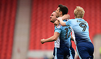 Blackpool's Jordan Flores, centre, celebrates scoring the opening goal from the penalty spot with team-mates Tom Aldred, left, and Mark Cullen<br /> <br /> Photographer Chris Vaughan/CameraSport<br /> <br /> The EFL Sky Bet League Two - Doncaster Rovers v Blackpool - Keepmoat Stadium - Doncaster<br /> <br /> World Copyright &copy; 2017 CameraSport. All rights reserved. 43 Linden Ave. Countesthorpe. Leicester. England. LE8 5PG - Tel: +44 (0) 116 277 4147 - admin@camerasport.com - www.camerasport.com