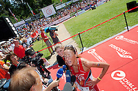 Chrissie Wellington speaks to the press at the finish line of the Challenge Roth Ironman Triathlon, Roth, Germany, 10 July 2011