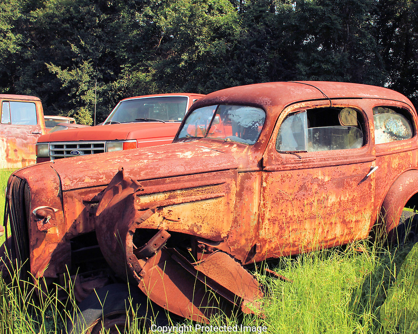 On a day trip from Summerville, SC to Aiken, SC, I spotted an e auto/truck junkyard right on Rt. 78. There were cars and trucks of all ages and this one especially intrigued me as it appears a remnant of the 30s or 40s. What is it? Can you tell?
