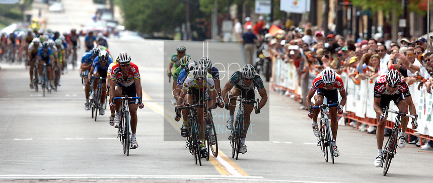 Racers sprint to the Macon, Ga. finish line during Stage 1 of the 2006 Ford Tour de Georgia pro cycling race. Lars Michaelsen (right) of Team CSC won 129-mile stage from Augusta to Macon in 4:45:46.<br />
