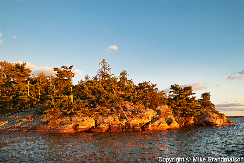 Shoreline of Lake of the Woods at sunset<br />