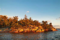 Shoreline of Lake of the Woods at sunset<br />Morson<br />Ontario<br />Canada