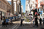 Cable car going up Powell Street, a hill in the Nob Hill neighborhood of San Francisco, California