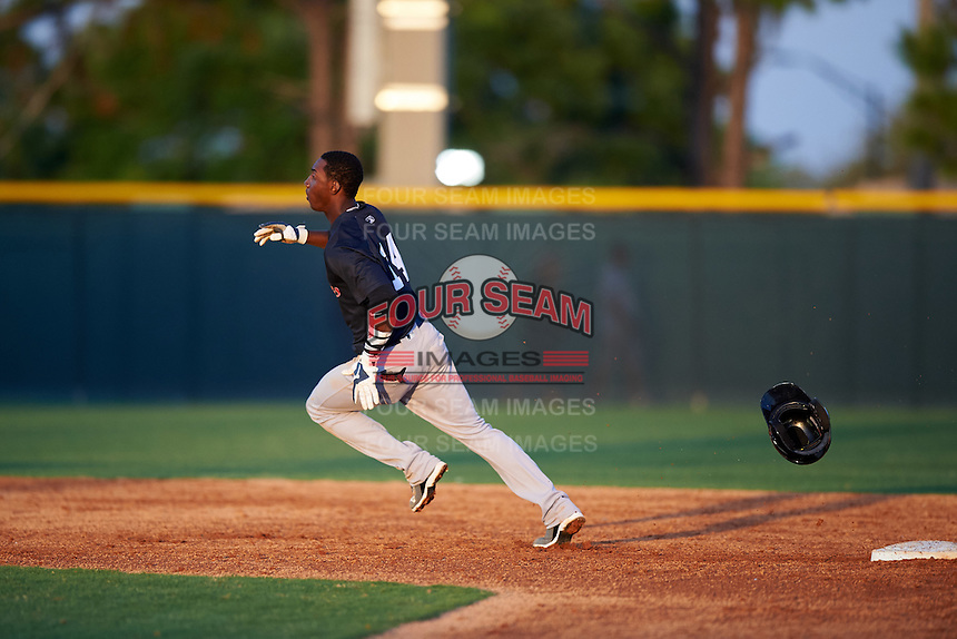 Tampa Yankees shortstop Jorge Mateo (14) loses his helmet rounding third while running the bases during a game against the Lakeland Flying Tigers on April 7, 2016 at Henley Field in Lakeland, Florida.  Tampa defeated Lakeland 9-2.  (Mike Janes/Four Seam Images)