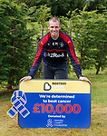 Kenny Miller hands over £10K from the Rangers Charity Foundation to Beatson Cancer Care.