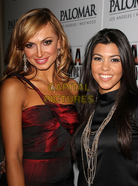 "KARINA SMIRNOFF & KOURTNEY KARDASHIAN.""A Night For Change"" An Alternative Intervention Models (A.I.M.) Benefit held at BLVD 16 Hotel Palomar, Westwood, California, USA..December 8th, 2008.half length black top jacket necklaces gold red dress sheer one shoulder .CAP/ADM/KB.©Kevan Brooks/AdMedia/Capital Pictures."