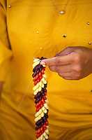 Making a seed lei