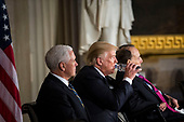 U.S. President Donald Trump drinks water as he is joined by Vice President Mike Pence and former Senator Bob Dole during a congressional Gold Medal ceremony, at the U.S. Capitol, in Washington D.C., U.S., on Wednesday, Jan. 17, 2018. Photographer: Al Drago/Bloomberg<br /> Credit: Al Drago / Pool via CNP