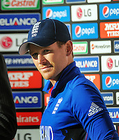 England captain Eoin Morgan waits to be interviewed after the ICC Cricket World Cup one day pool match between the New Zealand Black Caps and England at Wellington Regional Stadium, Wellington, New Zealand on Friday, 20 February 2015. Photo: Dave Lintott / lintottphoto.co.nz