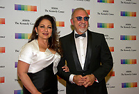 Gloria Estefan and her husband, Emilio Estefan, arrive for the formal Artist's Dinner honoring the recipients of the 40th Annual Kennedy Center Honors hosted by United States Secretary of State Rex Tillerson at the US Department of State in Washington, D.C. on Saturday, December 2, 2017. The 2017 honorees are: American dancer and choreographer Carmen de Lavallade; Cuban American singer-songwriter and actress Gloria Estefan; American hip hop artist and entertainment icon LL COOL J; American television writer and producer Norman Lear; and American musician and record producer Lionel Richie. Photo Credit: Ron Sachs/CNP/AdMedia