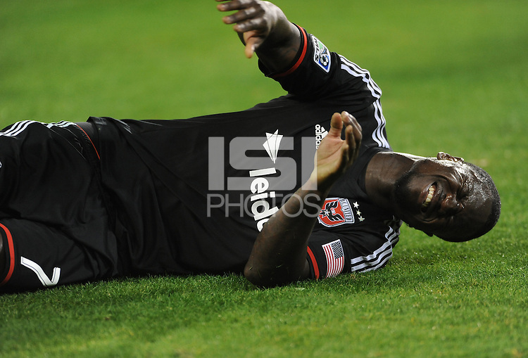 Washington D.C. - March 8, 2014: Eddie Johnson (7) of D.C. United goes down after a hard tackle.   The Columbus Crew defeated D.C. United 3-0 during the opening game of the 2014 season at RFK Stadium.