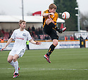 Alloa's Ryan McCord gets to the ball ahead of Ayr Utd's Neil McGregor.