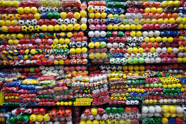 Plastic balls for sale displayed in the Yiwu Small Commodity Market. The city of Yiwu comprises of numerous export markets selling more than 17 million different products to more than 200 countries worldwide. The Small Commodities Market itself exports more than 320,000 separate products to over 130 countries.