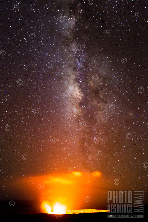 The Milky Way shines over the glowing light of Halema'uma'u Crater, seen near Jagger Museum, Hawai'i Volcanoes National Park, Hawai'i Island, June 2017.