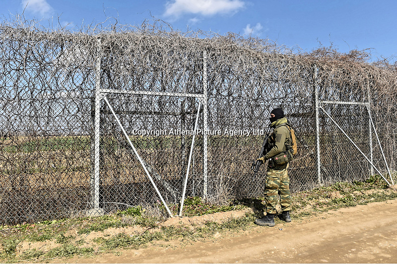 Pictured: A Greek soldier stands by the barb wired border. Sunday 01 March 2020<br /> Re: Clashes between migrants and riot police at the Greek-Turkish border of Kastanies near Evros, Greece