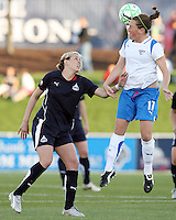 Jill Gilbeau #3 of the Washington Freedom watches Kasey Moore #17 of the Boston Breakers head the ball during a WPS match at the Maryland Soccerplex, in Boyd's, Maryland, on April 18 2009. Breakers won the match 3-1.