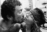 "Brazil. Sao Paulo state. Sao Paulo. Valdenir kisses Magda José, both live in the streets as a couple, They are ""catadores"" , men who collect paper, metals, bottles ... in order to sell these items as recycled materials and make a living. Waste collectors. © 1994 Didier Ruef .."
