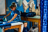 A Salvadoran woman irons an indigo-dyed scarf in an artisanal clothing workshop in Santiago Nonualco, El Salvador, 6 April 2018. For centuries, indigo, a natural deep blue dye extracted from the leaves of tropical plants, has been known to the native indigenous inhabitants of Central America. Nowadays, a growing demand for handmade, nature-based products has has permitted the emergence of various clothing workshops and cooperatives. Employing traditional design techniques and inspired by the ancient Mayan artists, they produce fashion collections, clothing accessories or decorative items on a sustainable, small scale basis.