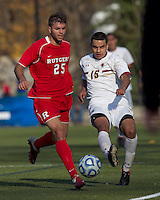 Boston College forward/midfielder Diego Medina-Mendez (15) passes the ball as Rutgers University midfielder Dragan Naumoski (25) pressures. Rutgers University defeated Boston College in penalty kicks after two overtime periods in NCAA Division I tournament action, at Newton Campus Field, November 20, 2011.