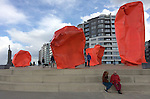 """Ostend-Belgium, March 27, 2016 -- """"Rock Strangers"""" by Belgian artist Arne Quinze at the waterfront of Ostend / Ostende; new, modern apartment buildings squeeze a classic home -- Photo: © HorstWagner.eu"""