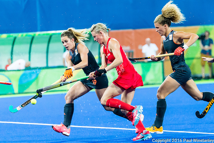 Ellen Hoog #19 of Netherlands and Alex Danson #15 of Great Britain contest the ball followed by Maria Verschoor #11 of Netherlands during Netherlands vs Great Britain in the gold medal final at the Rio 2016 Olympics at the Olympic Hockey Centre in Rio de Janeiro, Brazil.