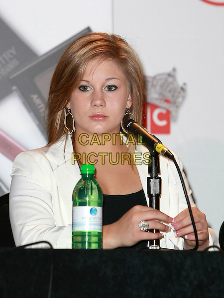 SHAWN JOHNSON.Miss America Judges Press Conference at the Planet Hollywood Resort Hotel and Casino, Las Vegas, Nevada, USA, 27th January 2010..half length  microphone sitting white jacket black earrings gold hoop hands ring .CAP/ADM/MJT.© MJT/AdMedia/Capital Pictures.