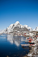 Scenic village of Reine in winter with snow covered moutnains, Lofoten Islands, Norway